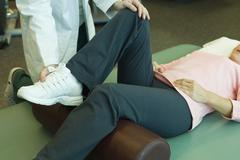 Patient receiving physical therapy treatment Stock Photos