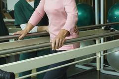 Patient undergoing post-surgery rehabilitation exercises to regain ability to Stock Photos