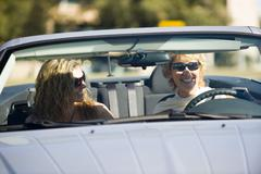 Young woman enjoying outing in car with mother - stock photo