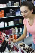 Young woman browsing cosmetics in store Stock Photos