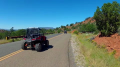 ATVs All Terrain Vehicles On Road Away From Camera- Sedona AZ Stock Footage