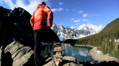 Female Hiker Blue Glacial Water Mountains Valley Travel Activity Destination Stock Footage