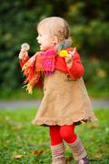 Little girl walking in the park Stock Photos
