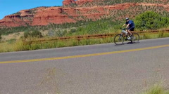 Bicycle Rider Past Camera On Road In Red Rock Country- Sedona AZ Stock Footage