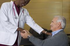 Doctor reassuring patient in waiting room Stock Photos