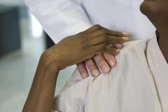 Doctor reassuring patient, cropped Stock Photos