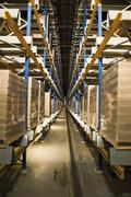 Automated Storage and Retrieval System, AS/RS, operating in the dark to conserve Stock Photos