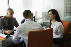 Businessman meeting with clients Stock Photos