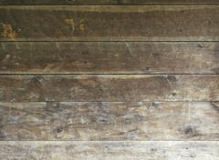 background texture of rough surfaced wood siding on country structure - stock photo