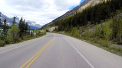 POV Highway 93 Canada Nature Beauty Snow Mountains Glacial Valley Forests Stock Footage