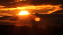 Fiery sunset with sun into clouds. Timelapse. Stock Footage