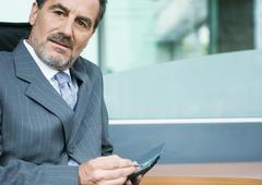 Businessman using PDA Stock Photos