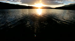 Unpolluted Wilderness Landscape Environment Mountains Lake Water Setting Sun - stock footage