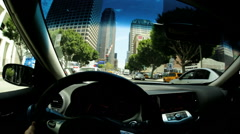 POV driving downtown commuter city road traffic USA Stock Footage