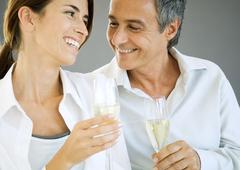 Couple holding champagne flutes Stock Photos