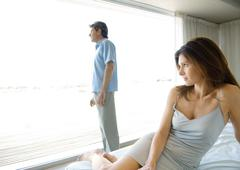 Mature couple, apart in bedroom Stock Photos