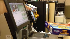Man paying a box of fish at the checkout counter Stock Footage