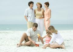 Group on beach - stock photo