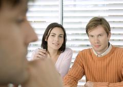 Couple having meeting with businessman Stock Photos