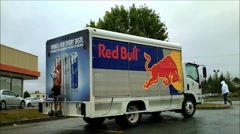 Red Bull energy drink delivery truck side and rear Stock Footage