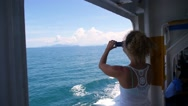 Stock Video Footage of Woman Sailing on Ferry and Taking Photo