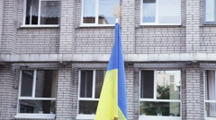 Ukrainian flag school yard - stock footage