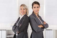 team portrait: successful business woman making career in management position - stock photo