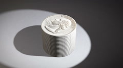 An Animation of a Stack of Quarters Turning Into a Pie Chart Stock Footage