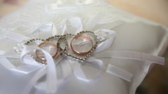 wedding rings on a small pillow - stock footage