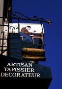 Upholsterer shop sign in French - stock photo