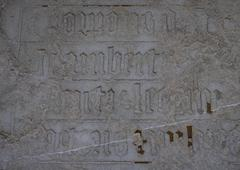 Stock Photo of Gothic writing engraved in stone.