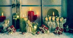 Atmospheric classic christmas decoration with angels, presents and red candle Stock Photos