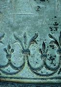 Floral motif in bronze, close-up - stock photo