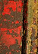 Chipped red paint on surface, close-up Stock Photos