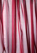 Folds in sheer red fabric, close-up, full frame Stock Photos