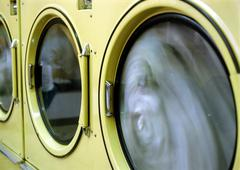 Clothes drying in laundrymat - stock photo