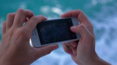Woman Hands Shooting Sea with Smart Phone. Slow Motion. Stock Footage