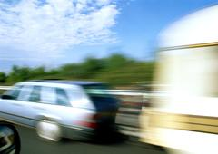 Station wagon with mobile home attached, blurred motion Stock Photos