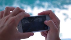 Female Hands Shooting Sea Waves with Smart Phone. Slow Motion. Stock Footage