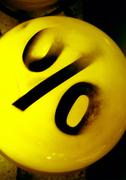 % text in black on yellow ball - stock photo