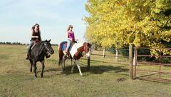 Two women riding horseback - stock footage