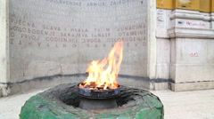 The Eternal flame in Sarajevo, a memorial to the military and civilian victims. - stock footage