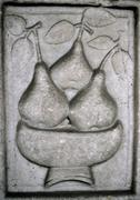 Pears in bowl, relief carved in stone Stock Photos