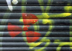 Radioactive warning symbol on roller shutter, close-up Stock Photos