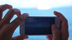 Closeup of Hands Filming Boat. Slow Motion. Stock Footage