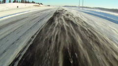 Windy winter highway with blowing snow - stock footage