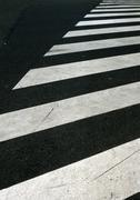 Pedestrian crossing lines on road, close-up Kuvituskuvat