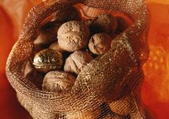 Walnuts in burlap sack, one golden Stock Photos