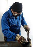 Man using welding torch Stock Photos