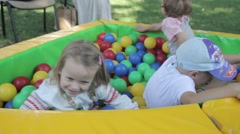 children play with colored balls. Childhood, child, day - stock footage